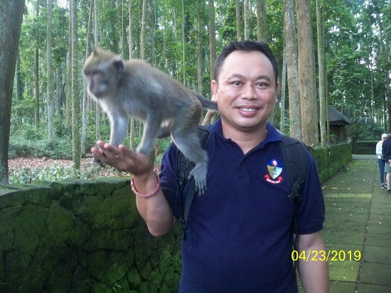 SANGEH ENGAGING WITH MONKEY SUBADRA BALI TOURISM DIRECTORY.jpg